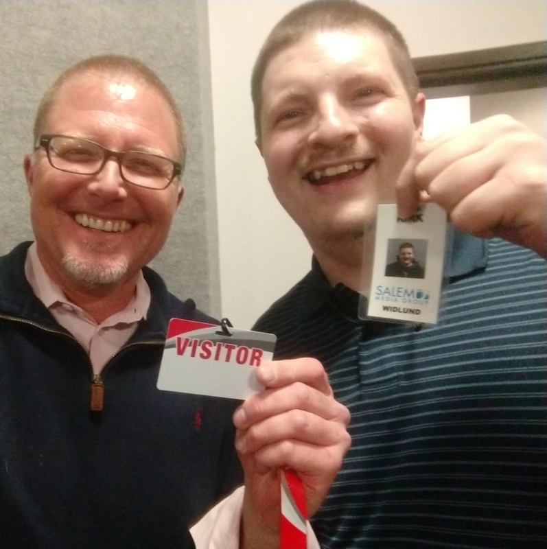 "Steffan Tubbs and Kirk Widlund holding badges. Stephan's says ""Visitor"" and Kirk's says ""Salem Media"""